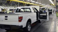 Employees at Ford's Kansas City assembly plant build the Ford F-150. The full-size pickup will be offered in a natural gas version in 2014. In Texas, where natural gas wells dot the landscape, pride may drive some buyers who want to consume the local fuel. (Sam VarnHagen Ford Motor Co.)