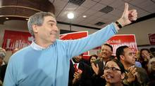 Liberal Party leader Michael Ignatieff greets supporters at his campaign headquarters in Toronto on Friday. (Reuters)
