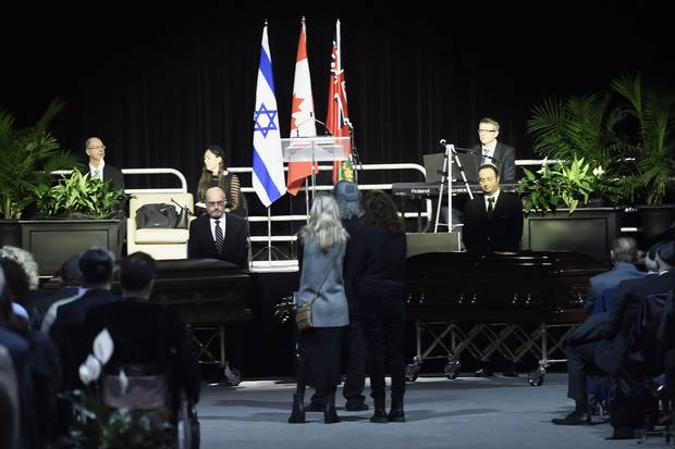 Dec. 21: The caskets arrive during a memorial service for the Shermans in Mississauga.