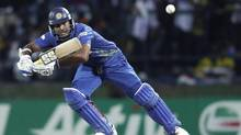 Sri Lanka's Kumar Sangakkara plays a shot during their Twenty20 World Cup Super 8 cricket match against West Indies in Pallekele September 29, 2012. (DINUKA LIYANAWATTE/REUTERS)