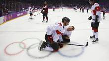 Canada's John Tavares is attended to by a trainer after being injured playing against Latvia during the second period of their men's quarter-finals ice hockey game at the Sochi 2014 Winter Olympic Games February 19, 2014. (MARK BLINCH/REUTERS)