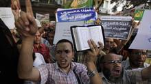 People shout and hold slogans in front of the U.S. embassy during a protest in Cairo on Sept. 11. (MOHAMED ABD EL GHANY/REUTERS)
