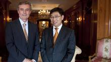 Edward Frackowiak, left, CEO of Wescast Industries Inc., and Dong Ping, CEO of Sichuan Bohong Industry Co. (Brett Gundlock/Brett Gundlock for The Globe and Mail)