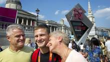 Sasha Mehmedovic, who will represent Canada in judo, in London's Trafalgar Square with his father, Nihad, and mother, Olivera. (Kevin Van Paassen/The Globe and Mail)