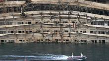 "The damaged side of the capsized cruise liner Costa Concordia is seen at the end of the ""parbuckling"" operation outside Giglio harbour September 17, 2013. (TONY GENTILE/REUTERS)"