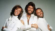 The Bee Gees, from left, Robin Gibb, Barry Gibb and Maurice Gibb, pose in this January, 1979, photo. (Associated Press)