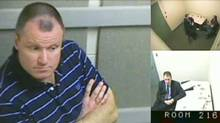 Col. Russell Williams is shown in this court-released image from his interrrogation by police captured on video and shown Wednesday in a Belleville, Ont. courtroom. Williams told police that while he did ask himself why he raped and killed women he could never come up with an answer and he was pretty sure the answers don't matter. (Handout/The Canadian Press)