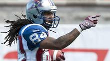 Montreal Alouettes' Trent Guy celebrates after scoring a touchdown agains the Toronto Argonauts during first half CFL football in Montreal, Sunday, September 23, 2012. (Graham Hughes/THE CANADIAN PRESS)