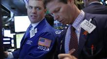 Traders work on the floor at the New York Stock Exchange, May 22, 2013. (BRENDAN MCDERMID/REUTERS)