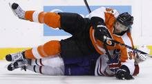 Philadelphia Flyers' Braydon Coburn, top, collides with Montreal Canadiens' Maxim Lapierre in the third period of Game 5 of the NHL hockey Eastern Conference finals, Monday, May 24, 2010, in Philadelphia. Philadelphia won 4-2 and took the series 4-1. (Matt Slocum/AP)