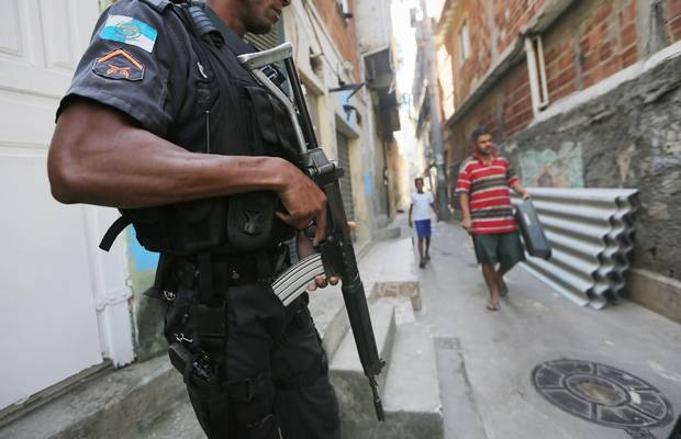 A UPP officer patrols in Babilonia.