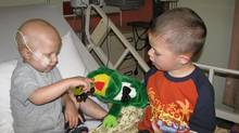 Brothers Oliver and Jax playing with the frog puppet in May 2010 at the Aberdeen Hospital in New Glasgow, while Oliver was receiving a blood transfusion. (Kaitlin Graham)