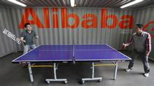 Employees play table tennis inside the headquarters office of Alibaba on the outskirts of Hangzhou, Zhejiang province in a file photo. (STEVEN SHI/REUTERS)