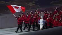 Hayley Wickenheiser carried the flag for Team Canada during the opening ceremony. Who will get the honour for Sunday's closing ceremony? (John Lehmann/The Globe and Mail)