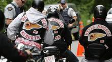 An RCMP officer stops Alberta members of the Hells Angels in 2008. The White Rock chapter was hosting the 25th anniversary party for the Vancouver, Nanaimo and White Rock branches of the group. (Darryl Dyck/THE CANADIAN PRESS)