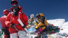 Shriya Shah-Klorfine, foreground, of Toronto, is shown at the summit of Mount Everest on May 19, 2012. She died while returning from the summit. (Utmost Adventure Trekking Pvt. Ltd./The Canadian Press/Utmost Adventure Trekking Pvt. Ltd./The Canadian Press)