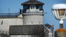 A guard walks along a catwalk at Kingston Penitentiary in Kingston,Ont. Thursday, April 19, 2012. (KEVIN VAN PAASSEN/THE GLOBE AND MAIL)