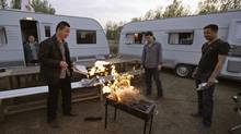 People light a barbecue grill during a camping trip at an RV park on the outskirts of Beijing. Chinese buyers bought an estimated 1,000 RVs last year, and the RV China Association expects sales to increase 40 per cent between 2012 and 2015 to close to 4,000. (ZHEYANG SOOHOO/REUTERS)