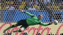 Germany's goalkeeper Manuel Neuer saves a shot from France's Mathieu Valbuena, during the World Cup quarterfinal soccer match between Germany and France at the Maracana Stadium in Rio de Janeiro, Brazil, Friday, July 4, 2014. (Frank Augstein/AP)