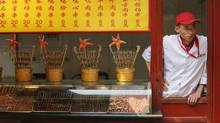 A food vendor waits for customers in Beijing May 6, 2013. Growth in China's services sector slowed sharply in April to its lowest point since August 2011, fresh evidence of rising risks to a revival in the world's second-largest economy. (KIM KYUNG-HOON/REUTERS)