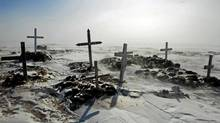 A Inuit cemetery outside the small town of Baker Lake, Nunavut. The territory is trying to bring its high suicide rate into line with the national average. (Nathan Denette/The Canadian Press)