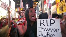 Protester Keisha Martin-Hall holds a bag of Skittles as she participates in a rally in response to the acquittal of George Zimmerman in the Trayvon Martin trial in Times Square in New York, July 14, 2013. (KEITH BEDFORD/REUTERS)