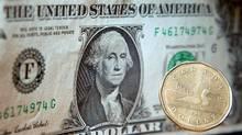 Loonie and U.S. dollar (Adrian Wyld/Adrian Wyld/CP)