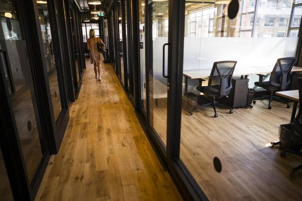 While unbuttoned, the work environment at WeWork's Toronto facility on Richmond Street West retains a professional aura. Tenant businesses pay membership dues and the amenities, in part, aim to impress investors and clients to show how serious their enterprises are.