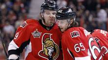 Ottawa Senators' Milan Michalek (L) and Erik Karlsson chat after Michalek's second goal of the game during the second period of their NHL hockey game against the Washington Capitals in Ottawa February 22, 2012. (BLAIR GABLE/REUTERS)
