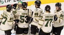London Knights celebrate their 22nd consecutive win, tied for the second longest winning streak in OHL history (Dave Chidley/THE CANADIAN PRESS)