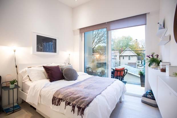 Glass doors flood the bedroom in natural light.