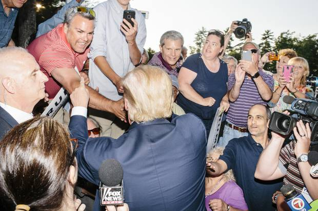 Real-estate mogul and Republican presidential candidate Donald Trump greets supporters after speaking at a rally at the Weirs Beach Community Center in Laconia, N.H.