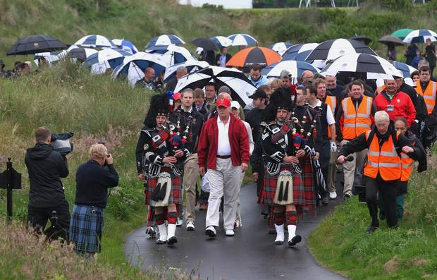 Donald Trump is followed by his guests as he officially opens the Trump International Golf Links golf course near Aberdeen, Scotland, in 2012.