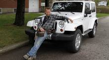 HGTV Canada's deck expert Paul Lafrance with his Jeep. (Fernando Morales/The Globe and Mail)