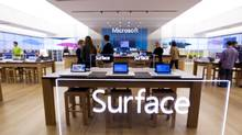 Staff prepare Thursday for the opening of the new Microsoft retail store in the Yorkdale Mall in Toronto. The new store is the company's first outside the U.S. (Peter Power/The Globe and Mail)