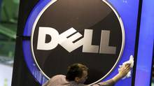 A man wipes Dell Inc.'s logo at an exhibition centre in Hanover in this Feb. 28, 2010 file photo. (THOMAS PETER/REUTERS)