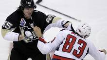 Pittsburgh Penguins' Arron Asham, left, and Washington Capitals' Jay Beagle (83) fight during the third-period of an NHL hockey game in Pittsburgh Thursday, Oct. 13, 2011. Beagle left the game bleeding from the face and the Capitals won in overtime 3-2. (AP Photo/Gene J. Puskar) (Gene J. Puskar/AP)