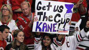 A fan of the Chicago Blackhawks holds up a sign that read