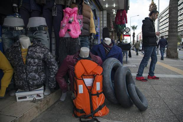 A clothes shop in Izmir sells life jackets for refugees.