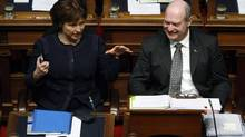 Premier Christy Clark with B.C. Finance Minister Mike de Jong, whose balanced budget offered little in the way of short-term benefits. (CHAD HIPOLITO/THE CANADIAN PRESS)