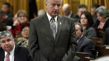 Defence Minister Rob Nicholson stands in the House of Commons during Question Period on March 4, 2014. (FRED CHARTRAND/THE CANADIAN PRESS)