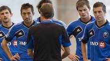Montreal Impact's Davy Arnaud, (2nd left) listens to head coach Jesse Marsch, as he talks with players during a training session in Montreal, Tuesday. (Graham Hughes/The Canadian Press)