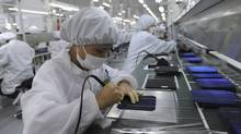 A solar components facotry in Hangzhou, China. Nearly half of the survey's Chinese respondents said more paid time off would help cut down on absenteeism. (LANG LANG/Lang Lang/Reuters)