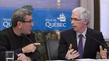 Quebec City Mayor Regis Labeaume, left, and Regional Health Director Francois Desbiens discuss the outbreak of legionnaire's disease in Quebec City on Aug. 24, 2012. (CLEMENT ALLARD/THE CANADIAN PRESS)