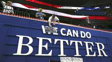 A Ron Paul for president supporter places a poster over a sign so that it reads 'Ron Paul Can Do Better' during the opening session of the Republican National Convention in Tampa on Monday. (Eric Thayer/Reuters)