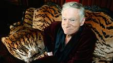 Hugh Hefner, CEO of Playboy Enterprises, poses for a photo during an interview with journalists at his mansion in Los Angeles, in 2006. (HECTOR MATA)