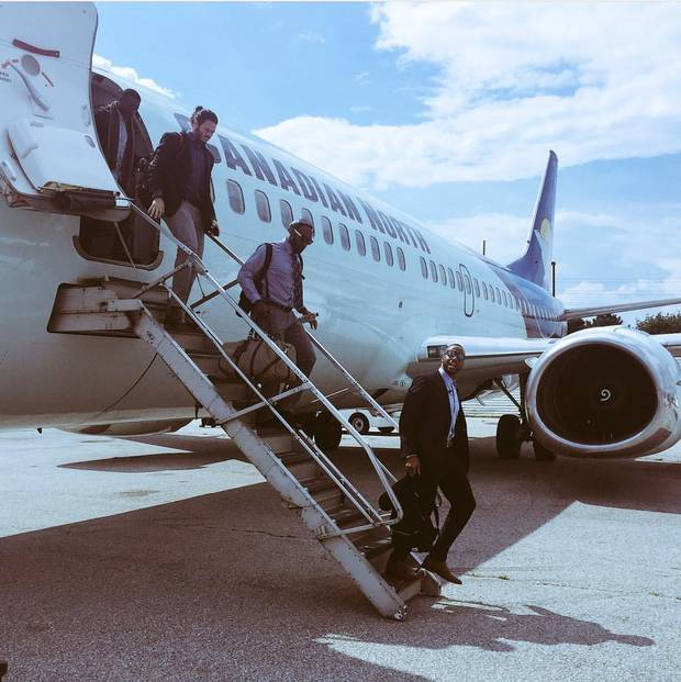 The Calgary Stampeders deboard a plane.