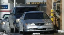 Cars lined up at a Tim Hortons drive through on Mavis Road in Mississauga. (Louie Palu/Louie Palu/The Globe and Mail)