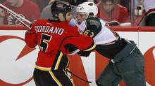 Calgary Flames' Mark Giordano (L) attempts to stop Minnesota Wild's Charlie Coyle from getting past him during the second period of their NHL game in Calgary, Alberta, February 11, 2013. (TODD KOROL/REUTERS)