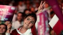 A Qatari girl celebrates in Doha after the tiny Gulf state was chosen to host the 2022 World Cup on December 2, 2010. (MARWAN NAAMANI/AFP/Getty Images)